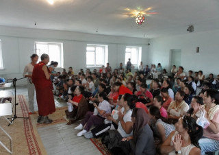 Panchen Otrul Rinpoche visiting a women's prison in Mongolia.