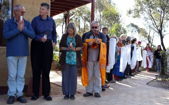 About 40 directors and SPC from FPMT centers, projects and services lined up to lead Rinpoche from Thubten Shedrup Ling Monastery to the Great Stupa to continue the oral transmission of the Golden Light Sutra, Australia, October 2014. Photo by Ven. Thubten Kunsang.