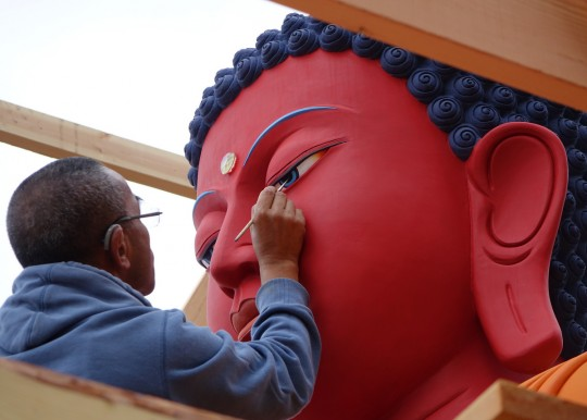 Artist Gelek Sherpa opening the buddha statue's eyes at Buddha Amitabha Pure Land, Washington, US, August 2014. Photo by Ven. Roger Kunsang.