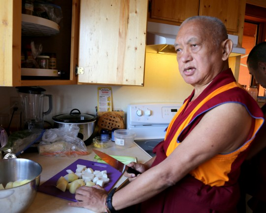 Lama Zopa Rinpoche showing how to make shemda -- potato, radish, mushroom, ping noodles and rice -- which would be the main dish that would be offered on the Amitabha Buddha celebration day, Buddha Amitabha Pure Land, Washington, US, August 2014. Photo by Ven. Thubten Kunsang.