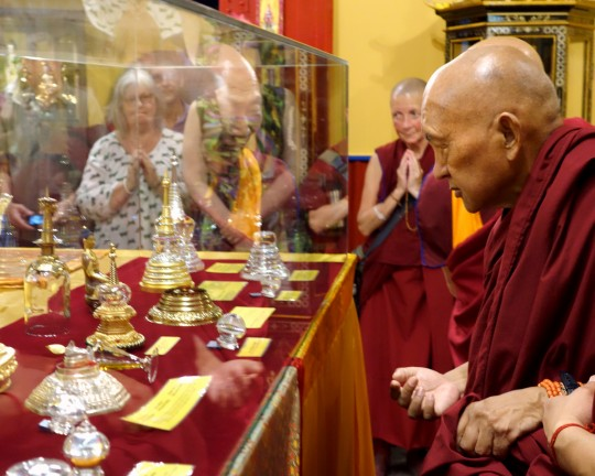 Lama Zopa Rinpoche viewing relics of Buddhist masters displayed in the newly remodeled relic room in the exhibition center at the Great Stupa of Universal Compassion,  Bendigo, Australia, October 2014. Photo by Ven. Roger Kunsang.