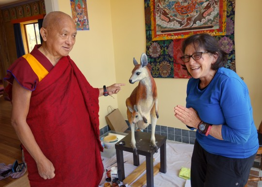 Lama Zopa Rinpoch visits with Lynn Miller Coleman as she paints the kangaroo statute, Thubten Shedrup Ling Monastery, Australia, October 2014. Photo by Ven. Roger Kunsang.