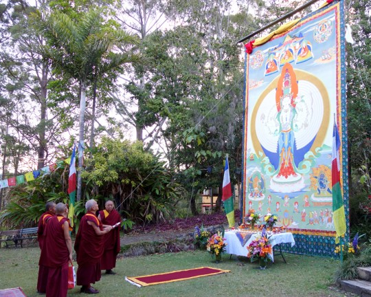Lama Zopa Rinpoche with large Chenrezig thangka at Chenrezig Institute, Eudlo, Queensland, Australia, September 2014. Photo by Ven. Roger Kunsang.