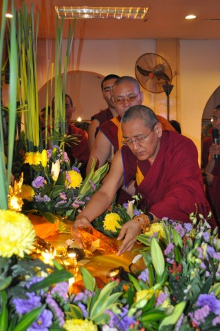 Khen Rinpoche Geshe Chonyi offering a large jewel to Dzambhala during the 1K Event 2013, Losang Dragpa Centre, Kuala Lumpur, Malaysia, October 2013. Photo by Elenie Tan.