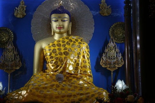 Beautiful Buddha in Mahabodhi Temple, Bodhgaya. The Puja Fund offers best quality robes to this statue every month. Photo by Thubten Kunsang.