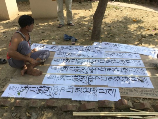 Mantras line the roof of the chicken coop at Root Institute, Bodhgaya, India, March 2015. Photo by Ven. Sarah Thresher.