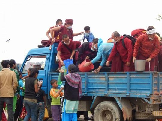 Kopan Monastery monks help distribute drinking water, Kathmandu, Nepal, April 2015. Photo via Facbook, Kopan Monastery School.