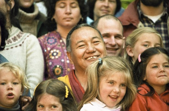 "Lama Yeshe with children and students in California, 1983. Lama Yeshe's proposal for education was to draw on the ""heritage of wisdom"" that resides in the great religious and philosophical traditions of the world to create a new kind of Universal Education. Photo courtesy of the Lama Yeshe Wisdom Archive."
