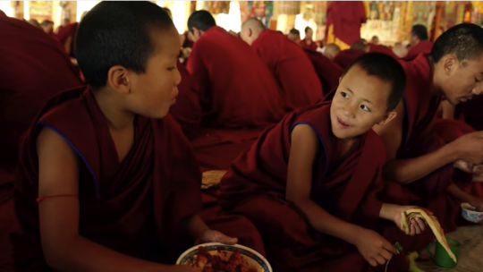 young monks eating
