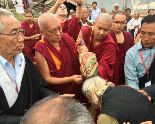 Lama Zopa Rinpoche blessing local Tibetans at the site of a new community hall Rinpoche is sponsoring, South India, December 2015. Photo by Ven. Holly Ansett.