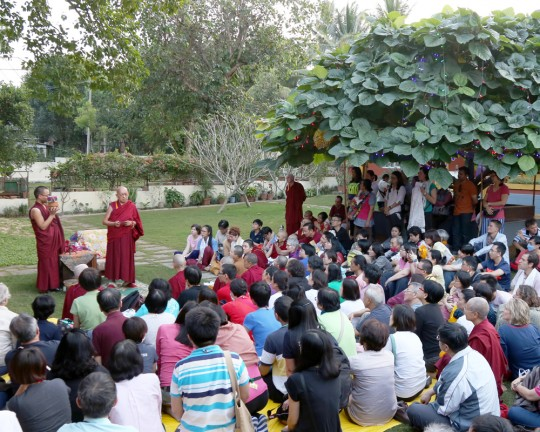 After the day's teachings with His Holiness the Dalai Lama, students gathered in the garden at Osel Labrang for Lama Zopa Rinpoche, who talked to students before giving blessings, Sera Monastery, India, December 2015. Photo by Ven. Thubten Kunsang.