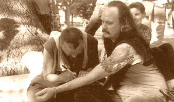 Rinpoche writes on the arm of a tattoo artist in Decatur, Illinois, August 97