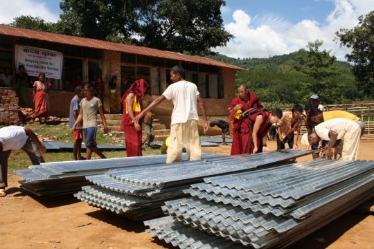 Roof sheets to protect from monsoon rains, Nepal, 2015