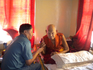 Doctor Checking the oldest monk 105 yo Kachen Laktho Tantric teacher of the monastery