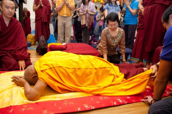 Lama Zopa Rinpoche making prostrations at Amitabha Buddhist Centre, Singapore, March 10, 2013. Photo courtesy of www.facebook.com/fpmtABC.