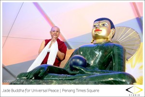 Geshe Deyang, one of Chokyi Gyaltsen Center's resident teachers, with Jade Buddha at Penang Times Square, Malaysia, April 2013. Photo by conceptd (conceptd.my/blog/).