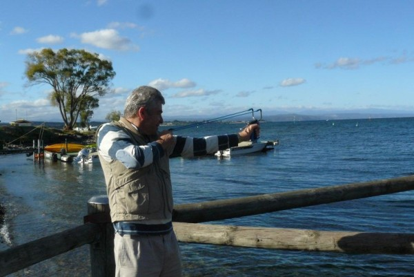 Murray Wright uses a slingshot to offer the Padmasambhava crystal to Lake Taupo, March 2013. Photo courtesty of Murray Wright.