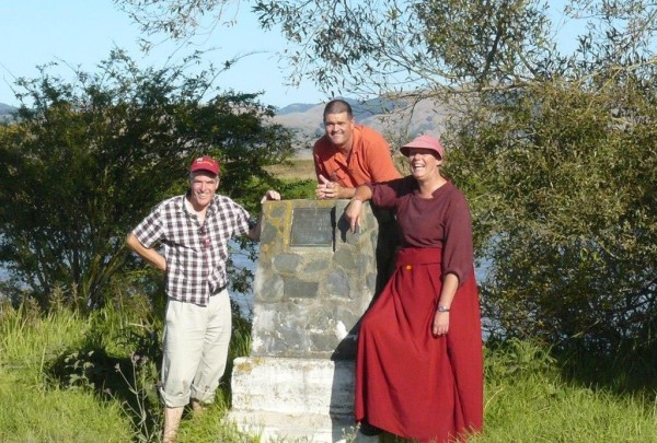 From left to right: Murray Wright, Brian Rae, and Ven. Tenzin Chogkyi. The site where Captain James Cook landed on the Waihou River in 1769, New Zeland, March 2013. Photo courtesy of Murray Wright.