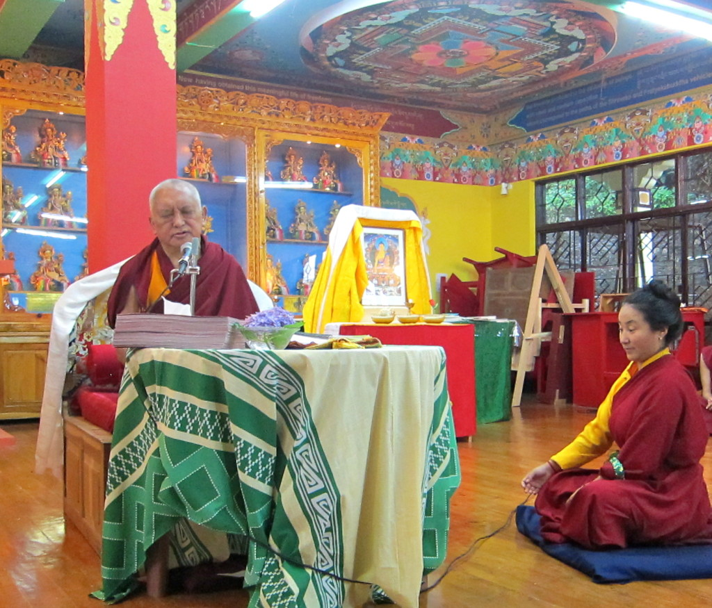 Lama Zopa Rinpoche during teaching on guru devotion with Khadro-la, Tushita Meditation Centre, India, June 2013. Photo by Ven. Sarah Thresher.