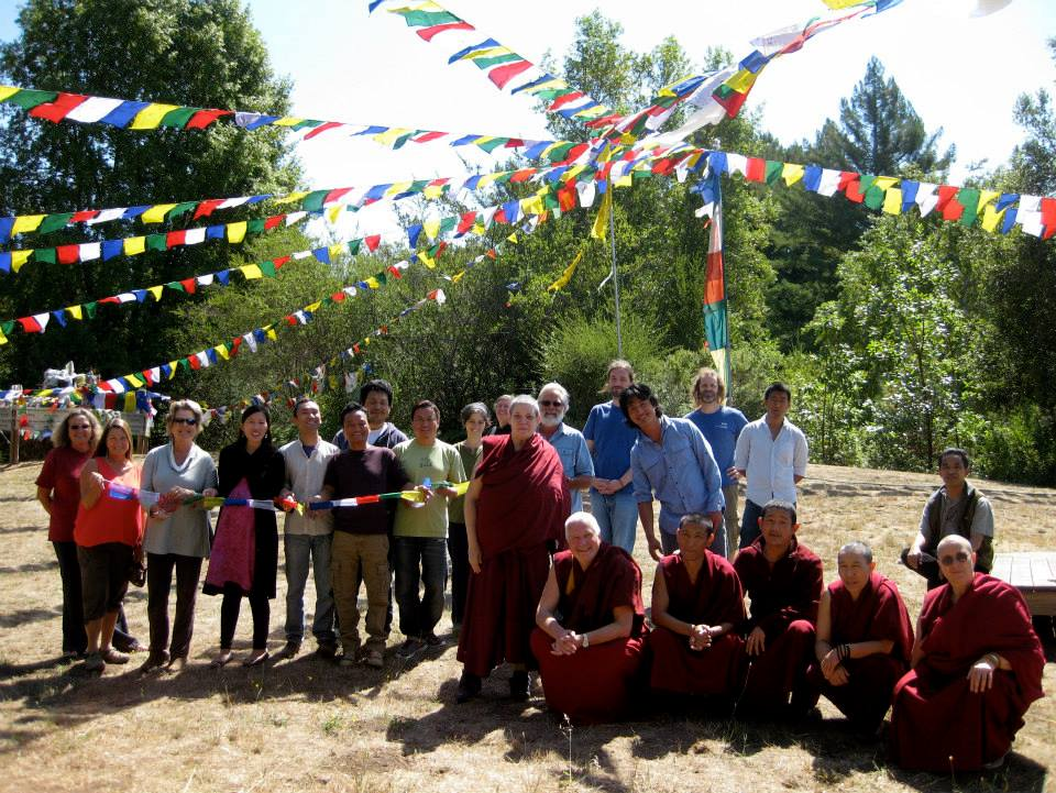 LMB community members after hanging new prayer flags, August 21, 2013. Photo courtesy of LMB's Facebook page.
