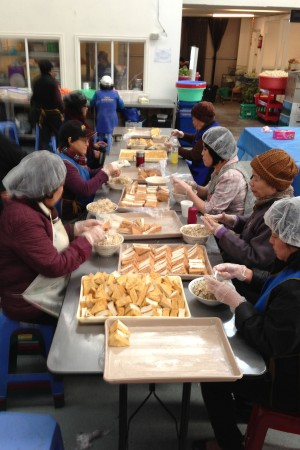 Vietnamese volunteers preparing food for Sangha, volunteers, and for sale to the general public. Photo by Cynthia Karena.