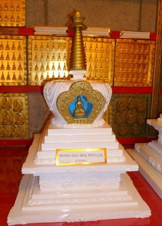 Stupa and wall of tsa-tsa tiles in shrine at Garden of Enlightenment, Queensland. Photo by Ray Furminger.