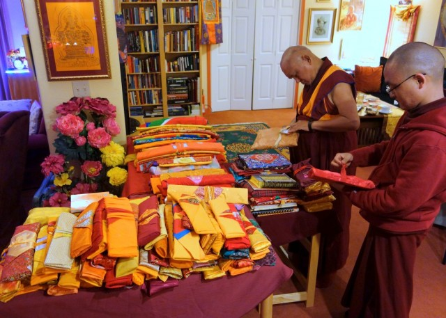 Lama Zopa Rinpche checking texts the night before departing for Nepal, Kachoe Dechen Ling, California, November 19, 2013. Photo by Ven. Roger Kunsang.