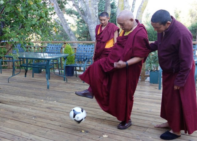 Lama Zopa Rinpoche exercising with a soccer ball, Kachoe Dechen Ling, California, October 2013. Photos by Ven. Roger Kunsang.