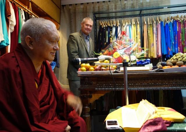 Lama Zopa RinpocheteachingtotheNepalistaffofYakandYetionthegoodheart. MarcelBertelsinthebackgroundwith someofthefinesilkclothingtheymanufacture.December 5,2013Photo byVen.RogerKunsang.