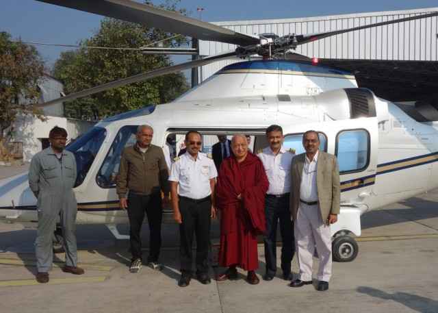 Lama Zopa Rinopche being flown to Kushinagar for Maitreya Project ceremony, December 13, 2013. Photo by Ven. Roger Kunsang.
