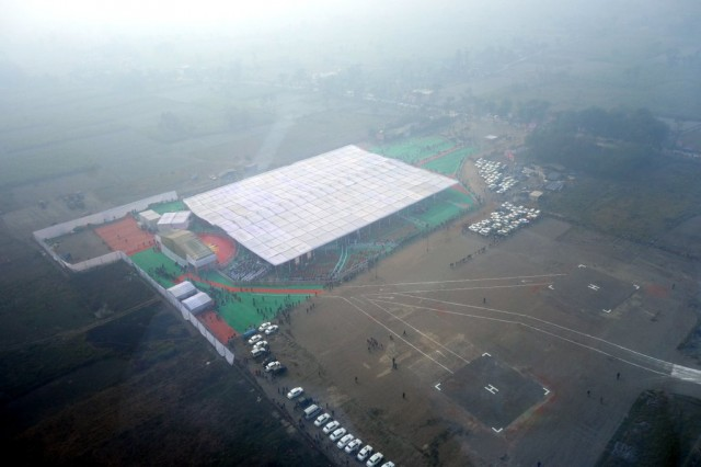 Aerial view of ceremony and Maitreya Project land, Kushinagar, India, December 13, 2013. Photo by Ven. Roger Kunsang.