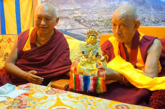 Lama Zopa RinpocheatdinnerwithKhensurRinpocheLosangTsering, Sera Monastery, India, December 2013. Photo by Ven.RogerKunsang.