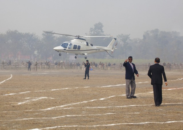 Helicopter carrying Lama Zopa Rinpoche landing at Kushinagar, India, December 13, 2013. Photo by Andy Melnic.