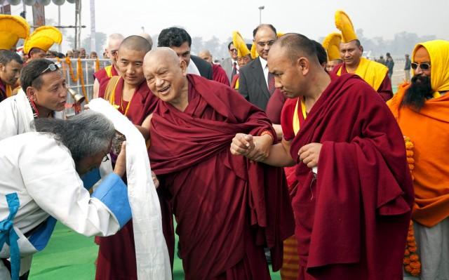 Lama Zopa Rinpoche being greeted, Kushinagar, India, December 13, 2013. Photo by Andy Melnic.