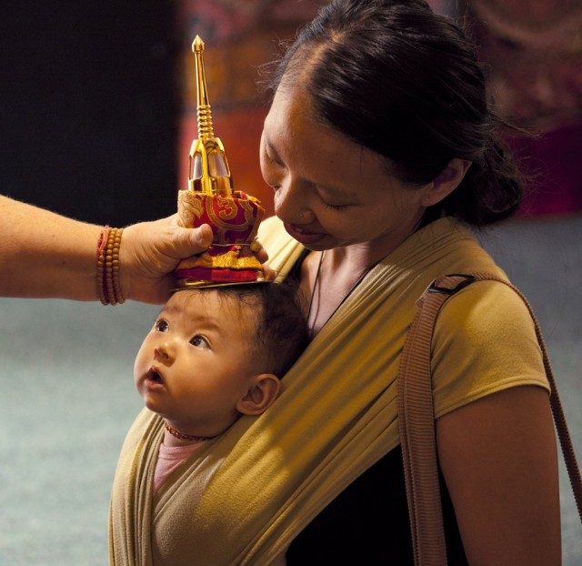 A mother and child receiving blessing from relics, Mullumbimby, Australia, 2012. Photo by Andy Melnic.