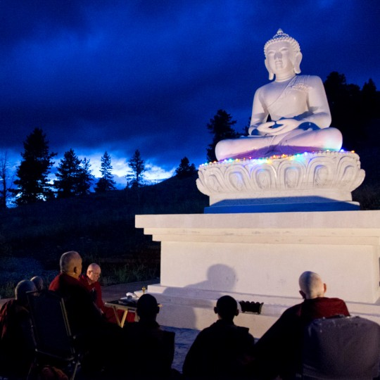 Lama Zopa Rinpoche and Sangha making prayers in front of new Amitabha Buddha statue at Buddha Amitabhe Pure Land, Washington, US, July 2014. Photo by Ven. Thubten Kunsang.