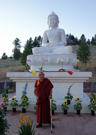 Lama Zopa Rinpoche with the new Amitabha Buddha statue at Buddha Amitabha Pure Land, Washington, US, July 2014. Photo by Ven. Roger Kunsang.