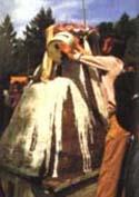 Whitewashing the cremation stupa.