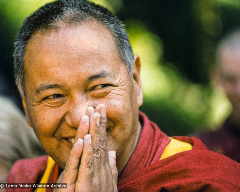 Lama Yeshe smiling with hands together in prostration mudra