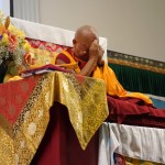 Rinpoche doing prayers for those who have died and who are seriously sick at the end of the day's teaching at the Llight of the Path retreat. Photo: Ven.Roger Kunsang, May 2014