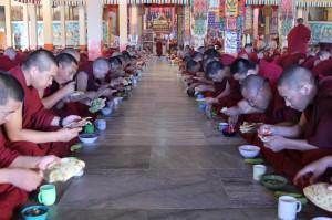 Monks enjoying breakfast together