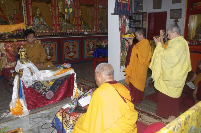 Lama Zopa Rinpoche taking transmission from Serkong Tsenshab Rinpoche, with Ven. Tsenla and Ven. Yeshe Khadro offering tsog. Bodhgaya, January 2012.