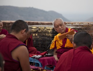 Lama Zopa Rinpoche giving the oral transmission of the Vajra Cutter Sutra on Vulture's Peak, Bihar, India, March 2014. Photo by Andy Melnic.