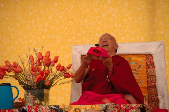 Lama Zopa Rinpoche with an Om Mani Padme Hum hat. CPMT meeting, France, 2009.