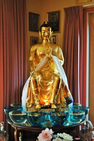 Life-sized gold leafed Maitreya statue, Kachoe Dechen Ling, California.