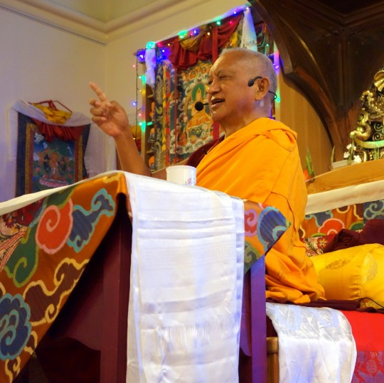 Lama Zopa Rinpoche teaching at Jamyang Buddhist Centre, London, July 2014. Photo by Ven. Roger Kunsang.