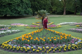 Lama Zopa Rinpoche offering all the flowers in the park to the guru, Leeds, UK, July 2014. Photo by Ven. Roger Kunsang.