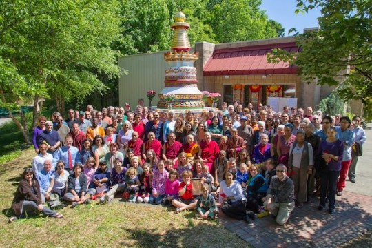 The Kadampa Center community with the finished stupa which took two years to complete. Photo by David Strevel.