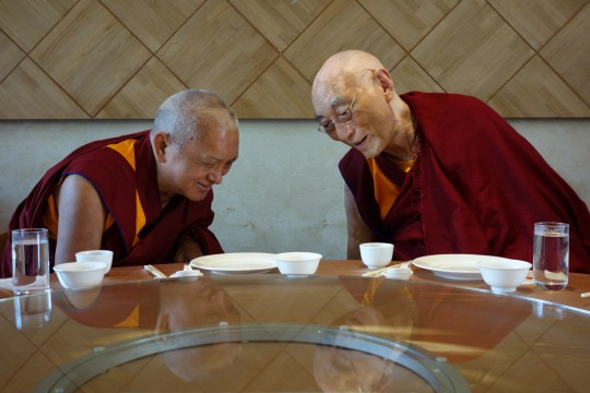 Lama Zopa Rinpoche offering lunch to Choden Rinpoche during Monlam, Taiwan, February 2013. Photo by Ven. Roger Kusang.