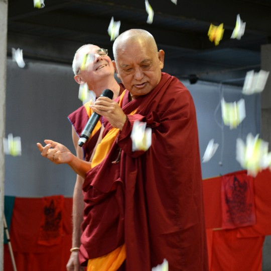 Flowers falling from above on Lama Zopa Rinpoche and Ven. Roger Kunsang following the public talk with Rinpoche, Great Stupa of Universal Compassion, Australia, September 20, 2014. Photo by Kunchok Gyaltsen.